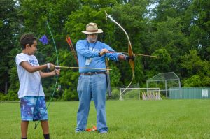 Rudy as Archery Instructor